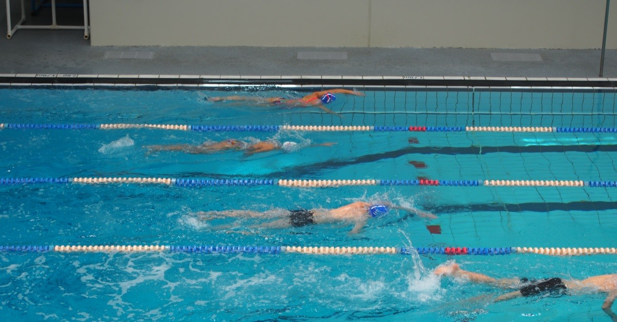 Observe swimmers from multiple angles